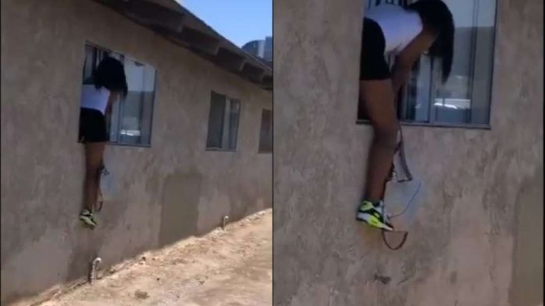 Trouble looms as side chick jumps over window to escape from wife of man she was bedding