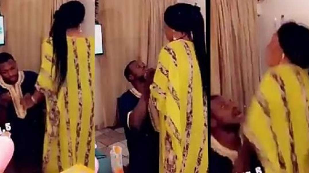 Man forcefully tries to put a ring on his girlfriend's finger as she rejects his proposal